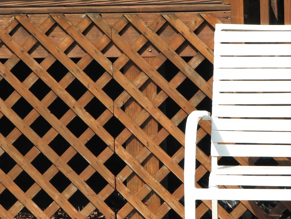 White chair by fence : Free Stock Photo