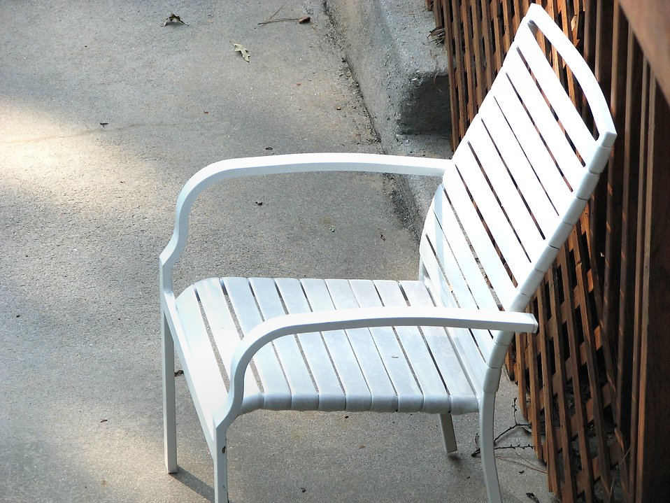 White chair against a fence : Free Stock Photo