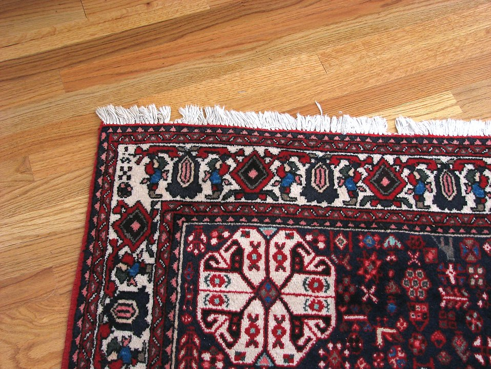 Rug on wooden floor : Free Stock Photo