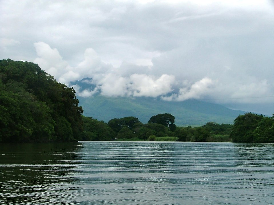 A calm river with distant mountains : Free Stock Photo
