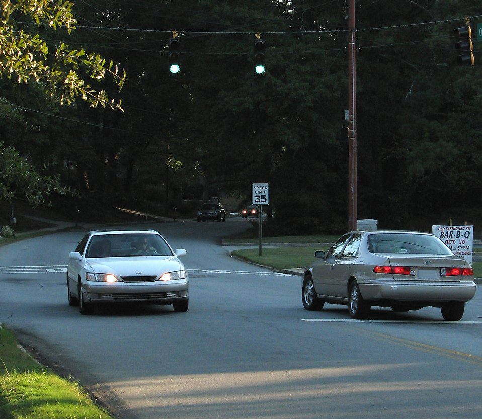 Cars driving at sundown : Free Stock Photo