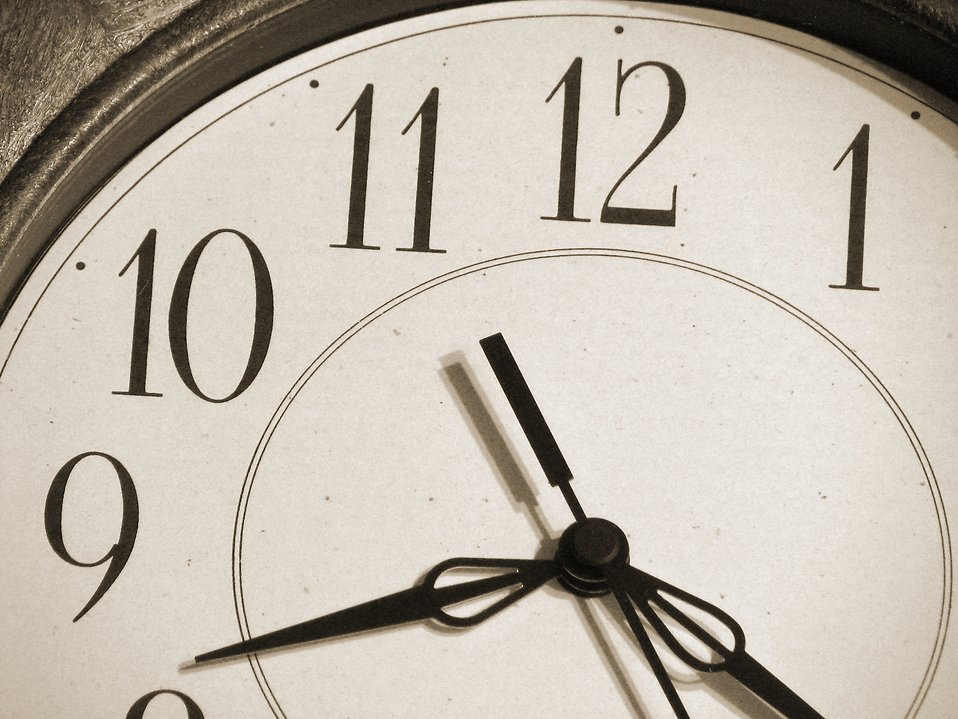 Closeup of a clock : Free Stock Photo