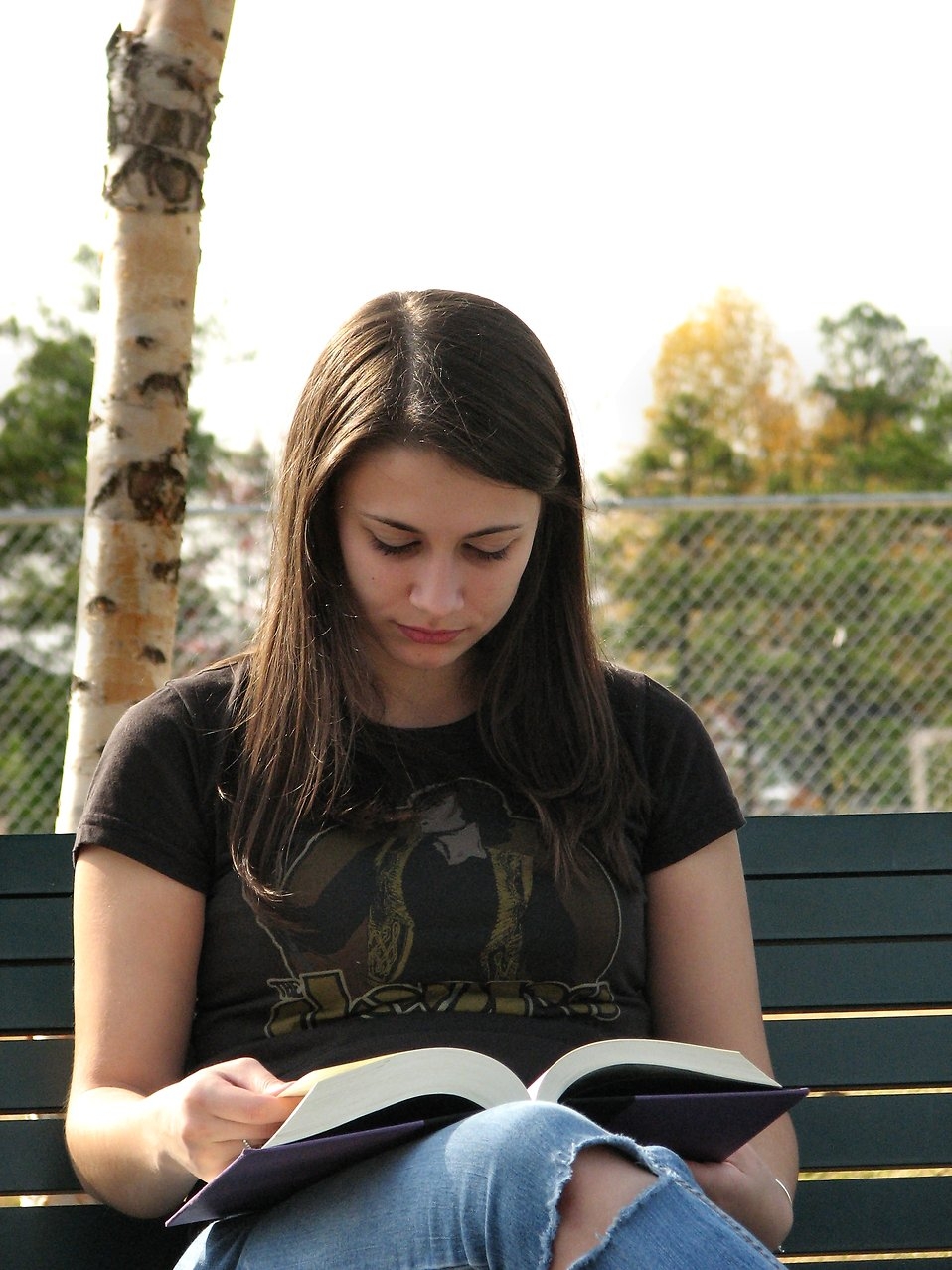 Closeup of teenage girl reading a book : Free Stock Photo