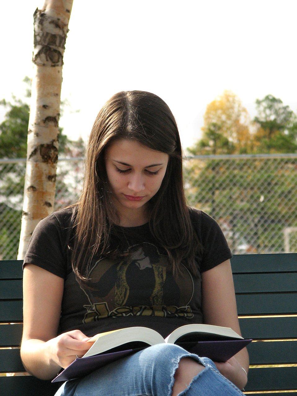 Closeup of teenage girl reading a book : Free Stock Photo