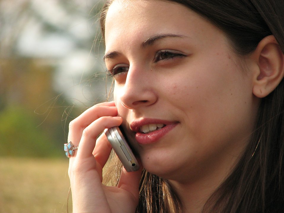 Teenage girl talking on a cell phone : Free Stock Photo