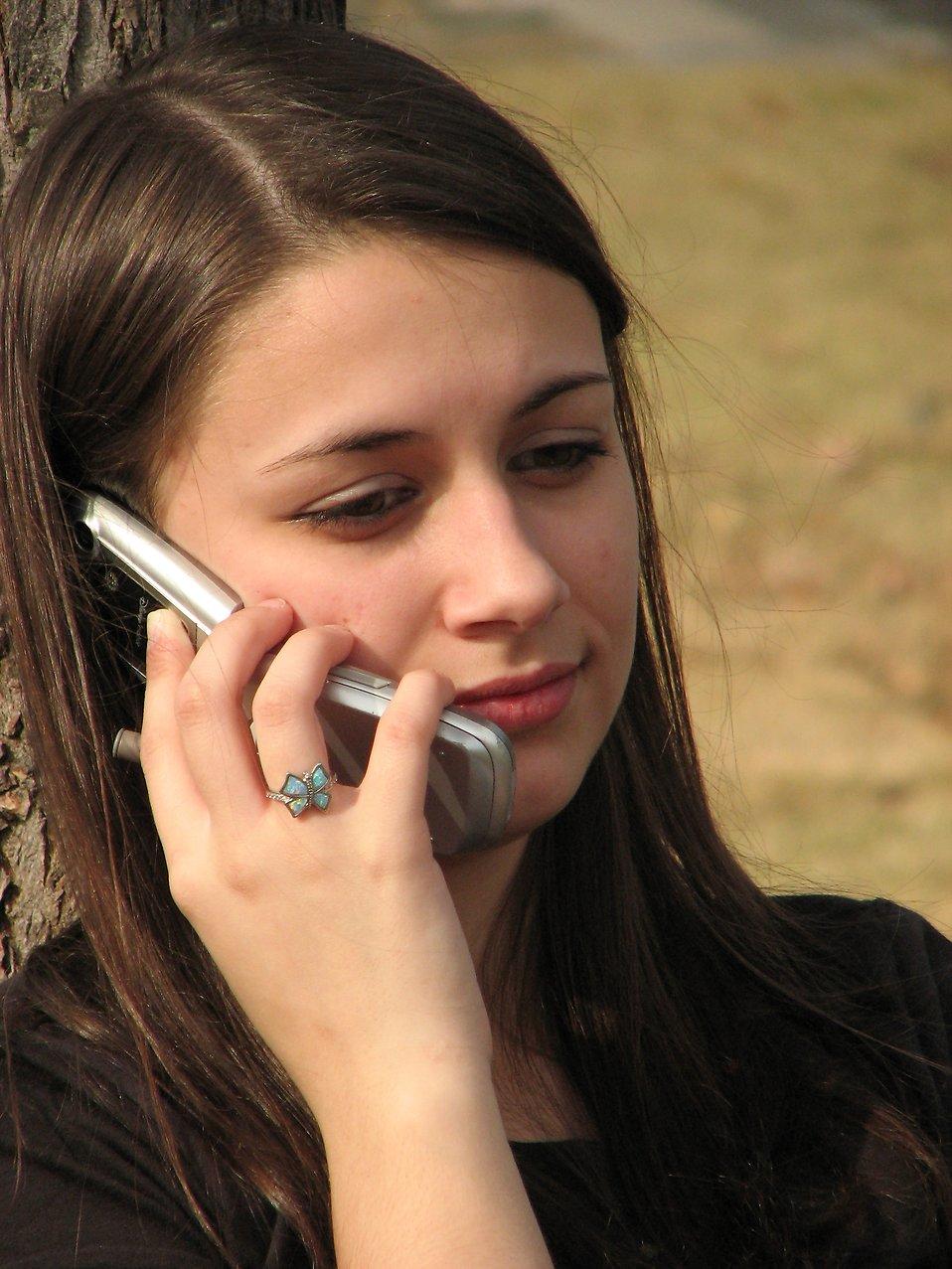 Cell Phone Girl   Free Stock Photo   Teenage girl talking