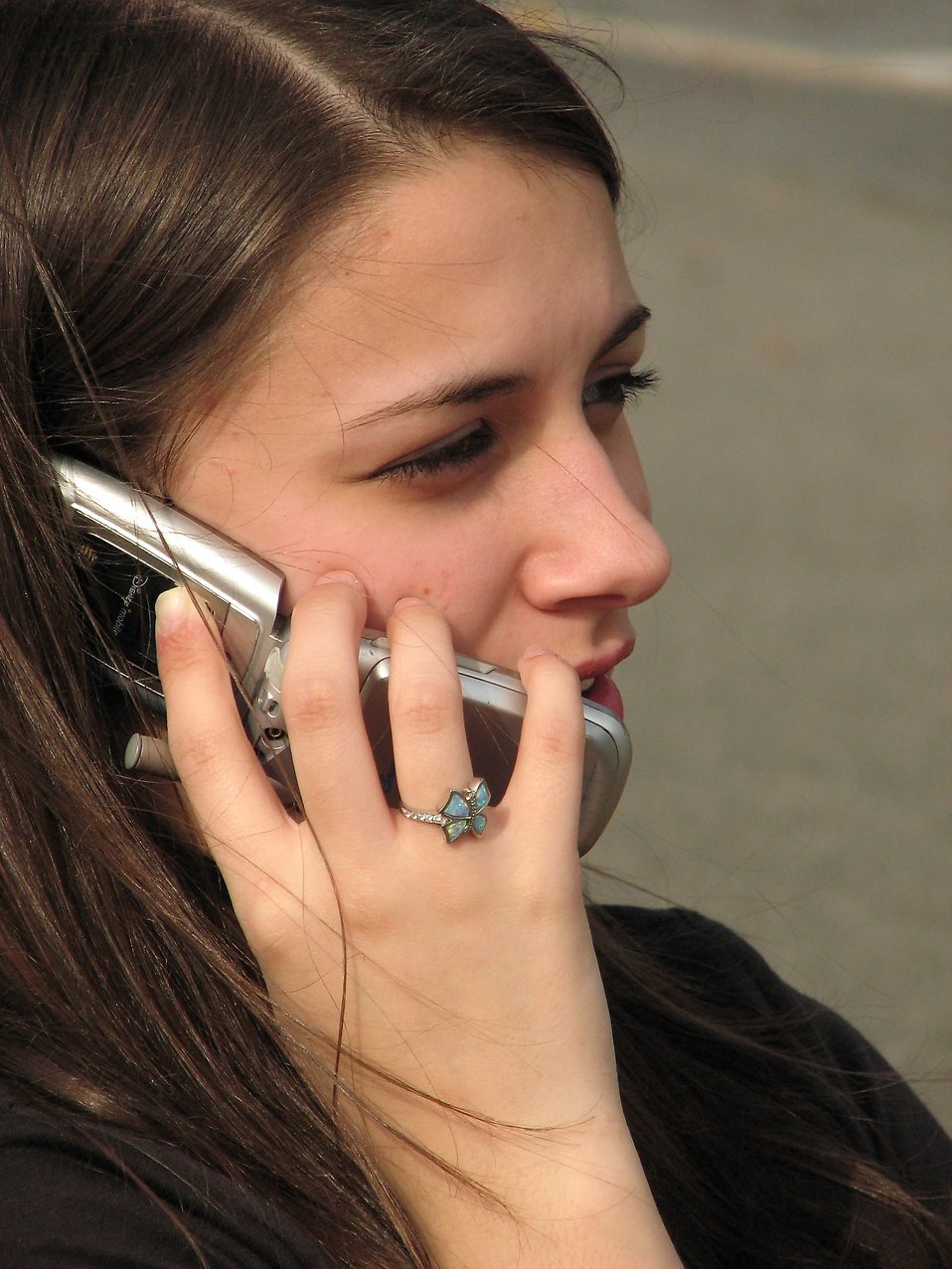 Closeup of teenage girl talking on a cell phone : Free Stock Photo
