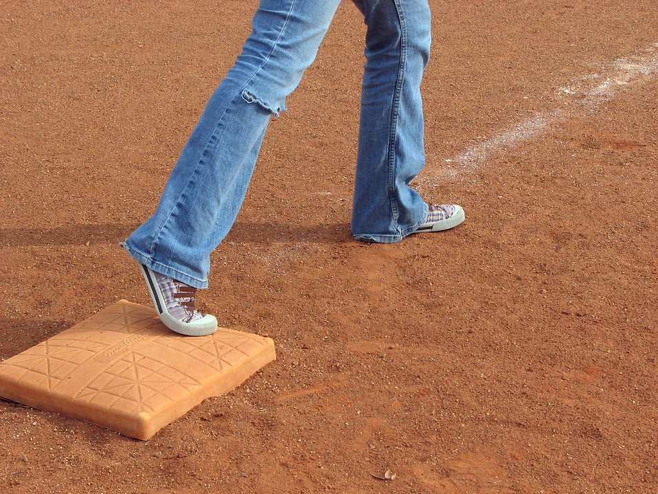 Feet on a baseball base : Free Stock Photo