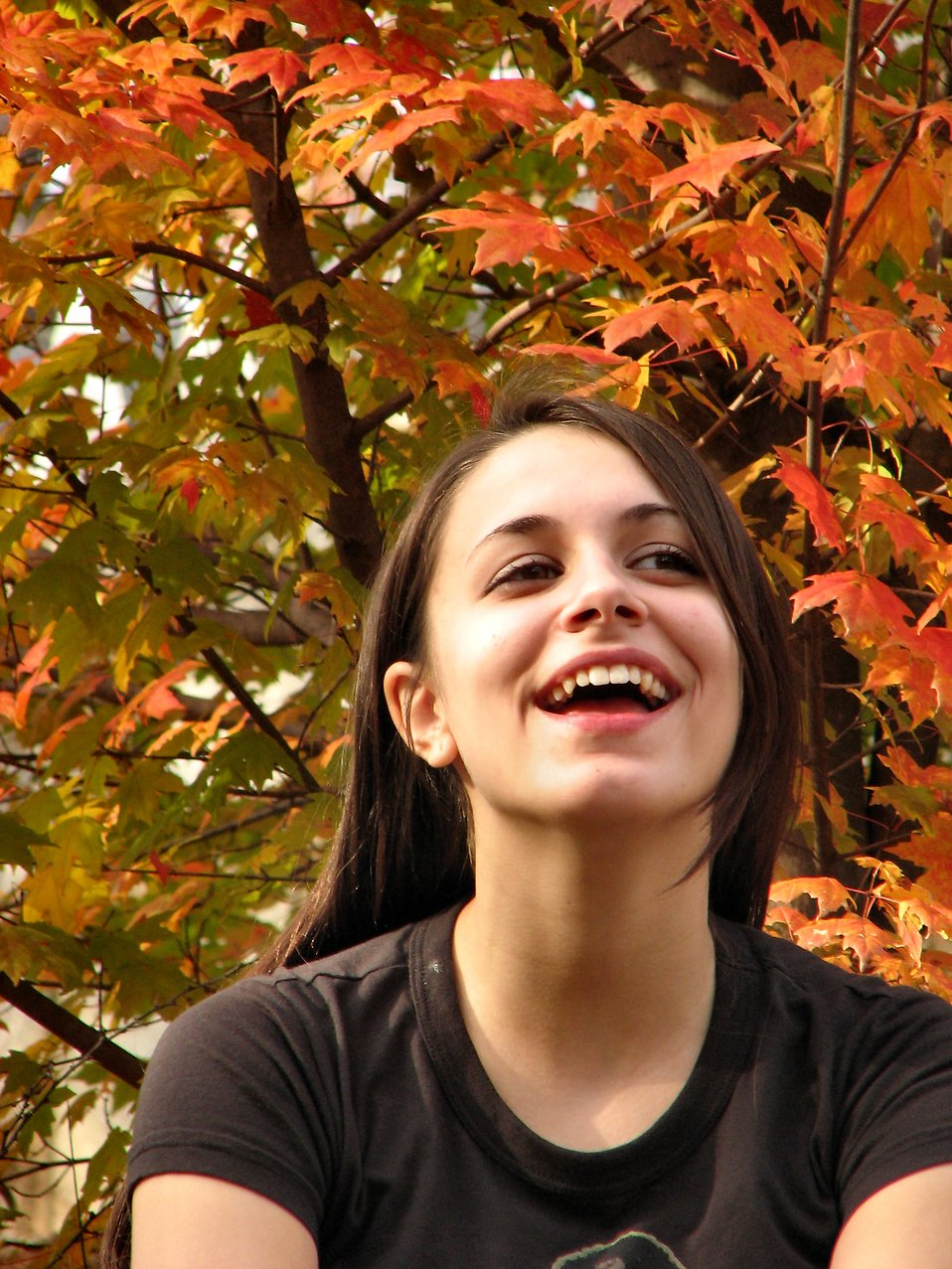 Closeup portrait of a teen girl outdoors : Free Stock Photo