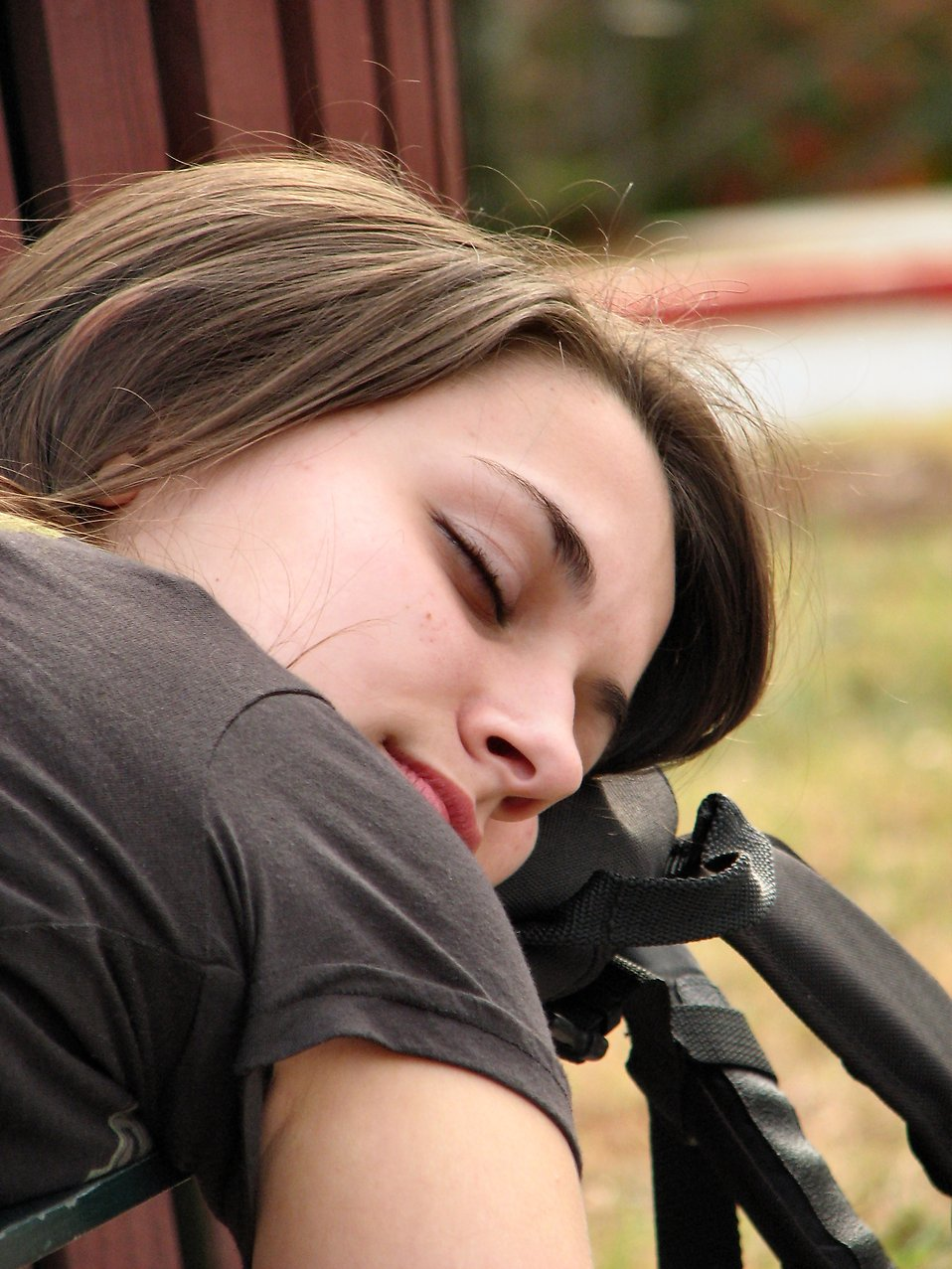 Closeup of a teen girl sleeping on a bench : Free Stock Photo