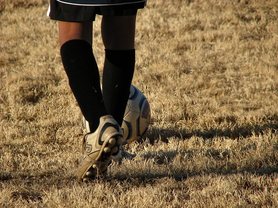 Boy playing soccer : Free Stock Photo