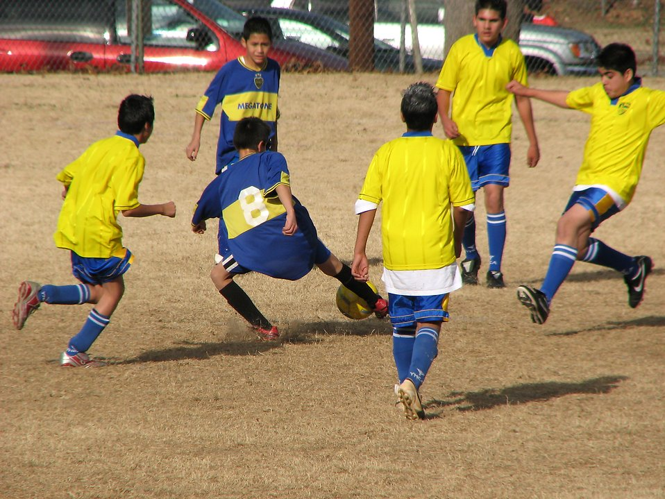 Boys playing soccer : Free Stock Photo