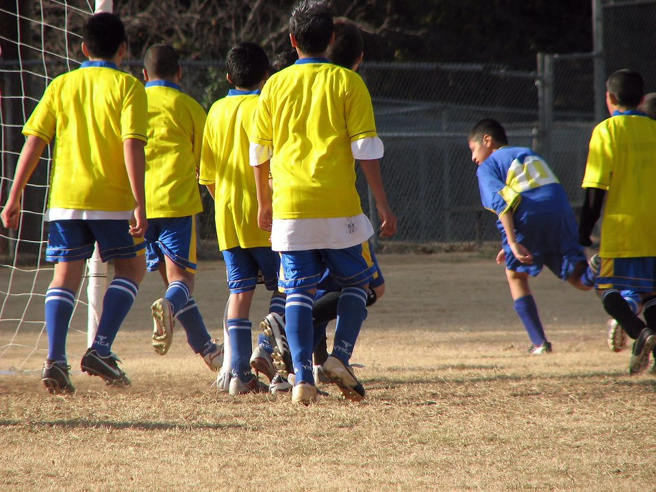 Group of boys playing soccer : Free Stock Photo