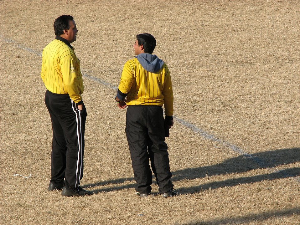Two soccer referees talking : Free Stock Photo