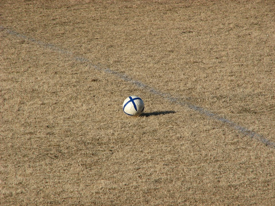 Soccer ball in middle of a field : Free Stock Photo