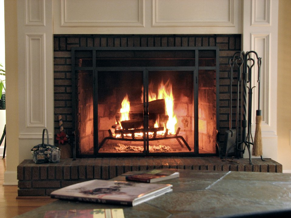 A white and brick fireplace : Free Stock Photo