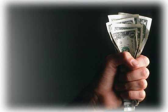 A fist holding a handful of dollars : Free Stock Photo