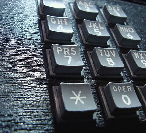 Closeup of a telephone keypad : Free Stock Photo