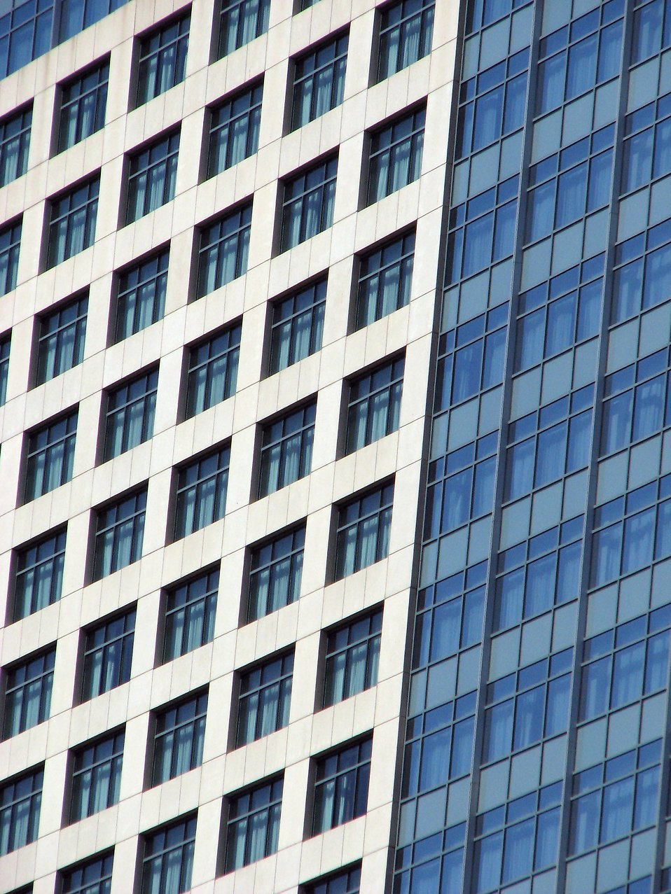 Close up side of a modern glass building : Free Stock Photo