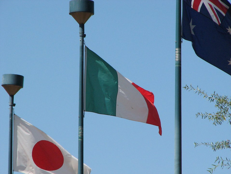 Japanese, Italian and Australian flag in blue sky : Free Stock Photo
