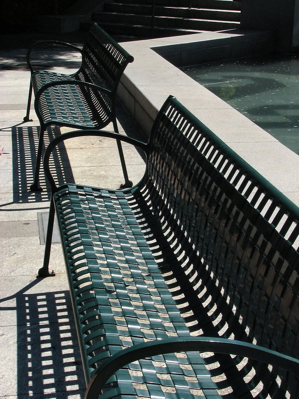 Park benches near a pool : Free Stock Photo