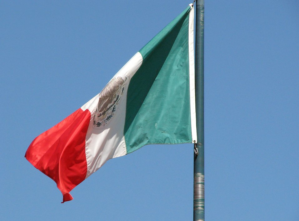 Mexican flag in blue sky : Free Stock Photo