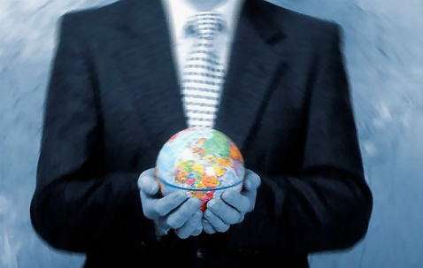 Businessman holding a globe : Free Stock Photo