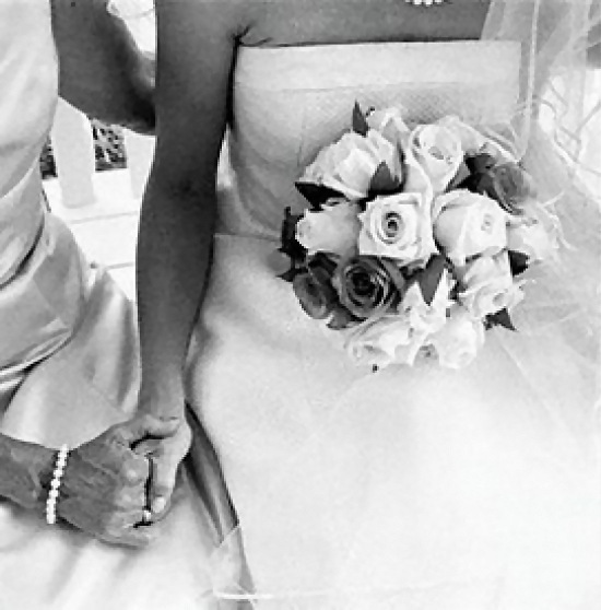 A bride holding a woman's hand : Free Stock Photo