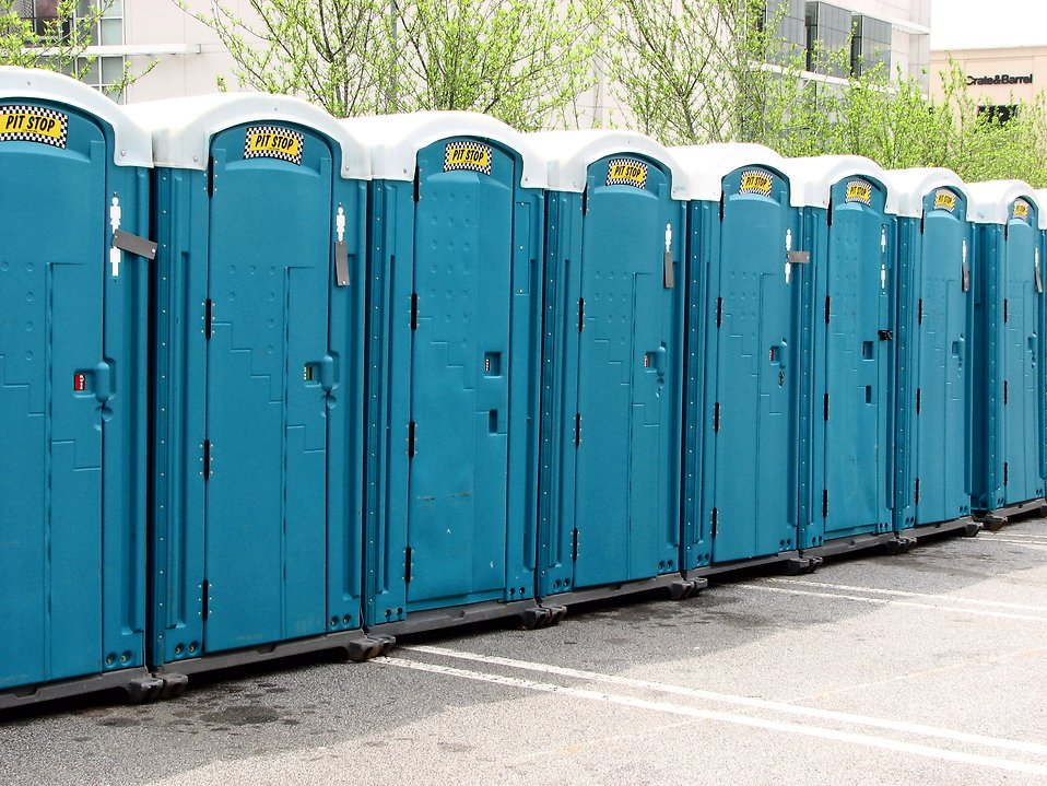 Row of blue outhouses : Free Stock Photo