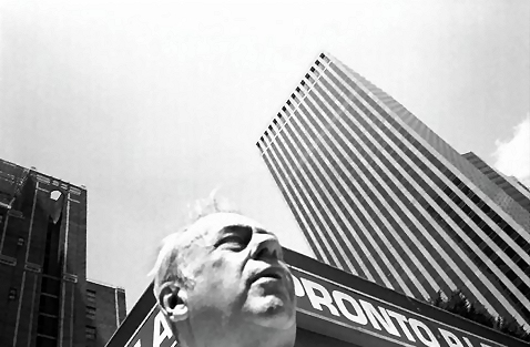 B&W man in front of a skyscraper : Free Stock Photo