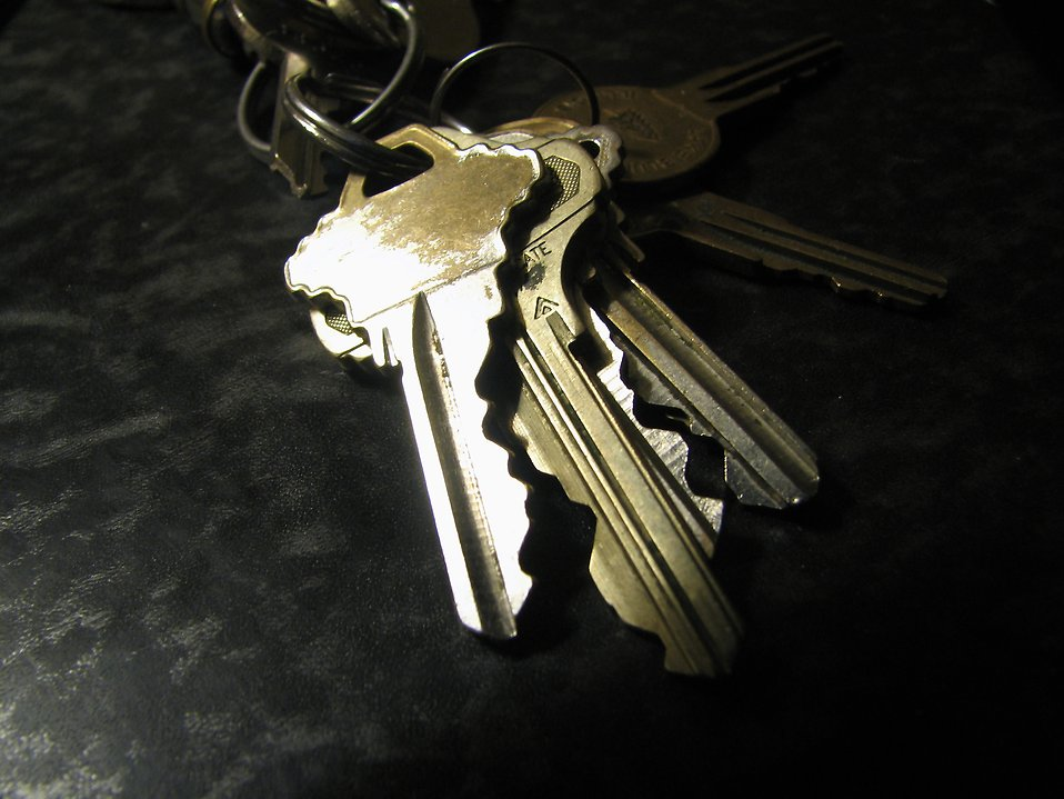 Closeup of shiny worn keys on a ring : Free Stock Photo