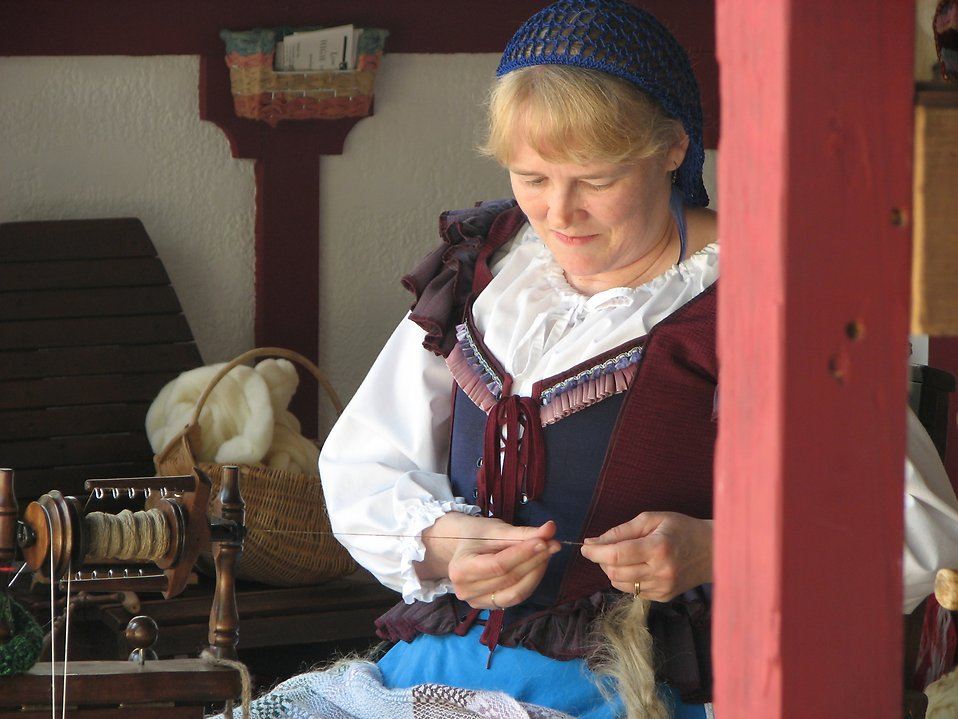 Medieval woman sewing : Free Stock Photo