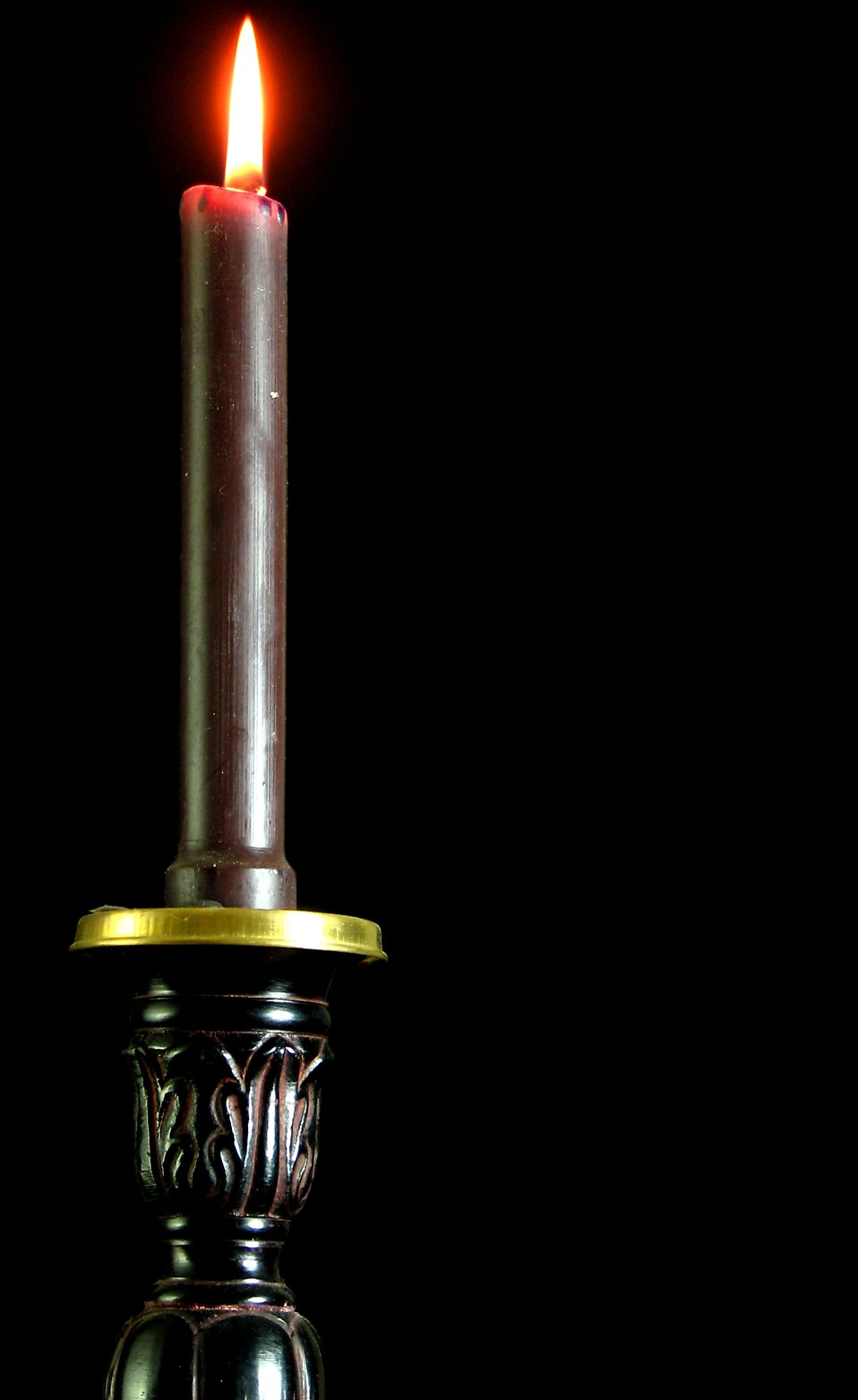 Closeup of black candle and candlestick : Free Stock Photo