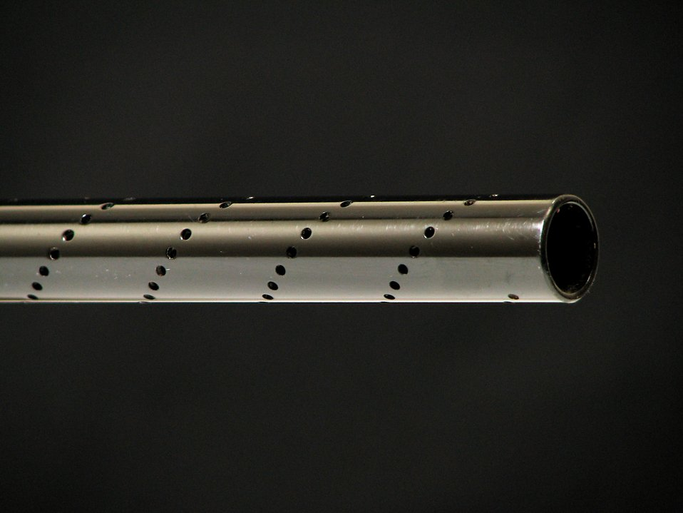 Closeup of black paintball gun barrel : Free Stock Photo