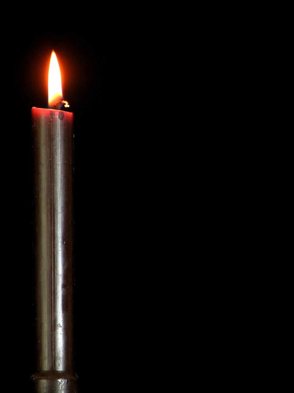 Closeup of a black candle burning : Free Stock Photo