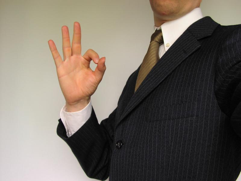 Business man in suit making OK symbol : Free Stock Photo