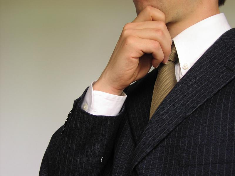 Business man holding his hand to chin : Free Stock Photo
