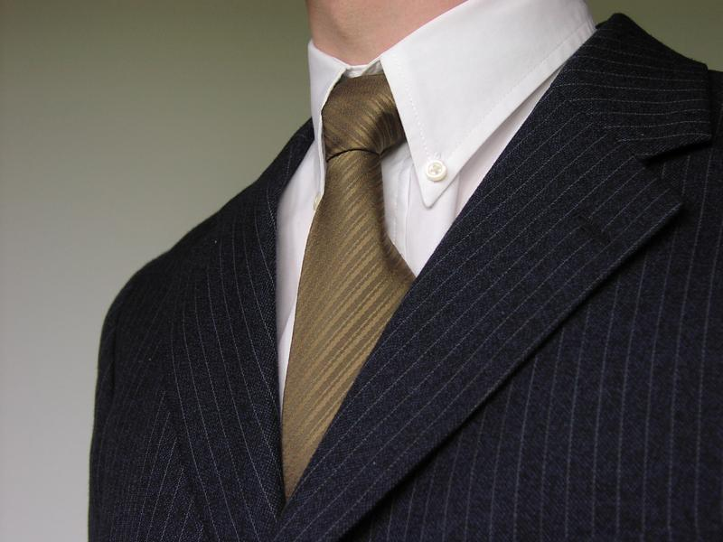 Closeup of a business man in suit and tie : Free Stock Photo