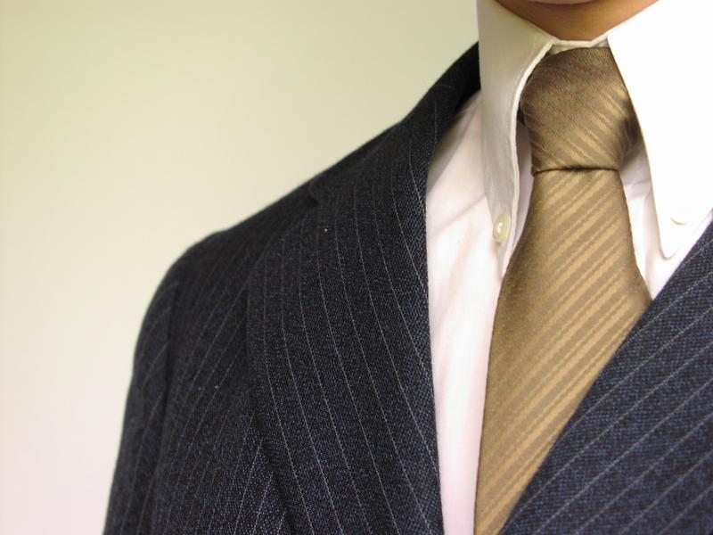 Closeup of business man in suit and tie : Free Stock Photo