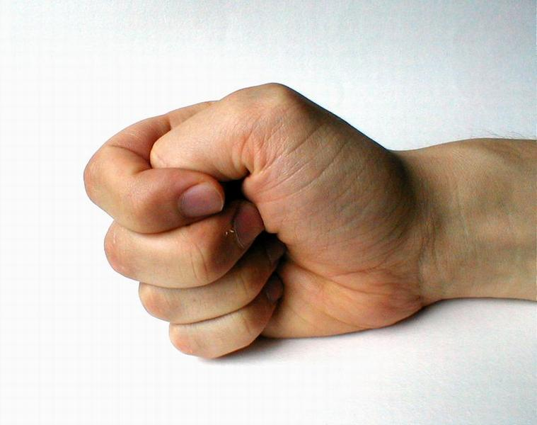 Closeup of a hand making a fist : Free Stock Photo