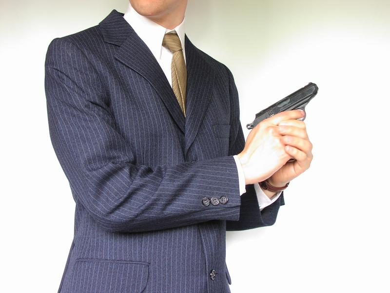 Man in a suit with a small pistol : Free Stock Photo