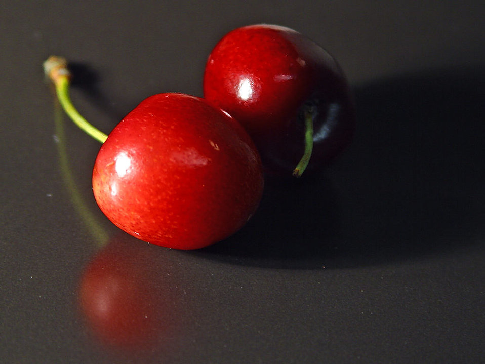 Closeup of two red cherries : Free Stock Photo