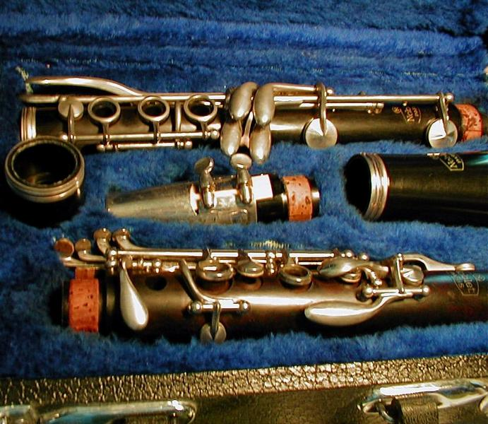 Closeup of a clarinet in a blue case : Free Stock Photo