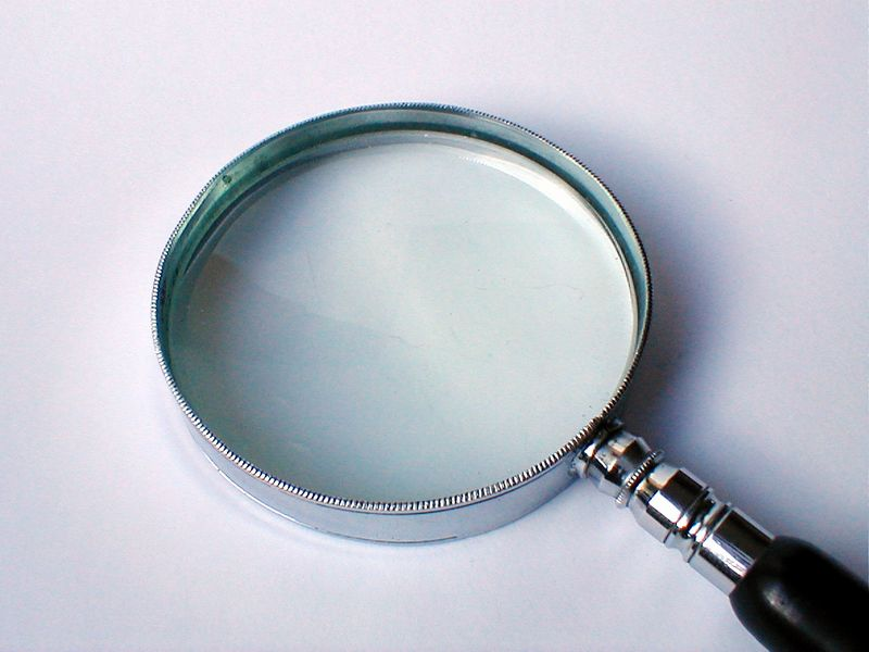 Magnifying glass on a white background : Free Stock Photo