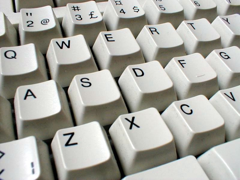 Closeup of a white keyboard : Free Stock Photo