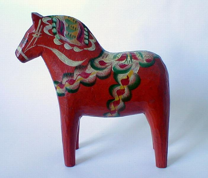 A red painted wooden toy horse : Free Stock Photo
