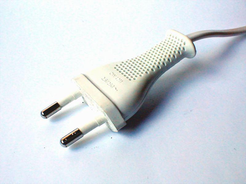 Closeup of a white electrical plug : Free Stock Photo