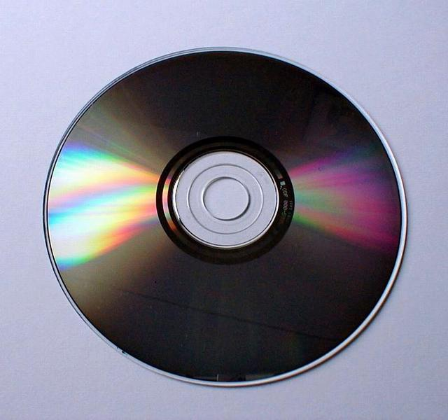 Closeup of a compact disc on a white background : Free Stock Photo