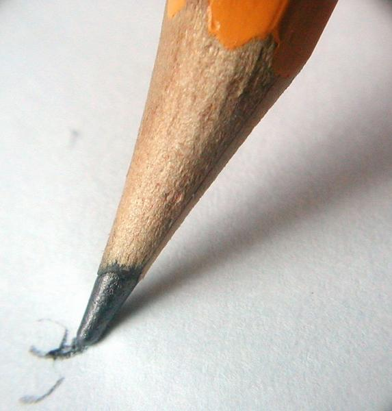 Closeup of a pencil writing on paper : Free Stock Photo