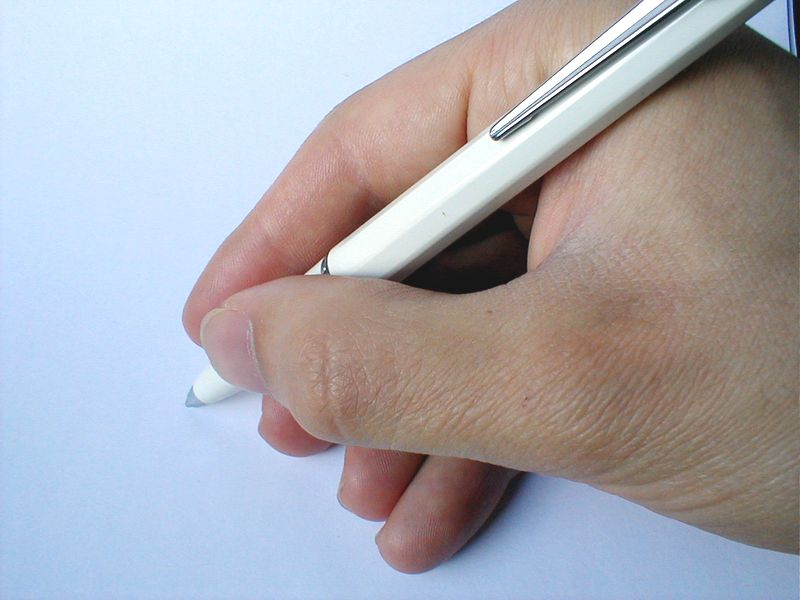 Closeup of hand holding a pen. : Free Stock Photo